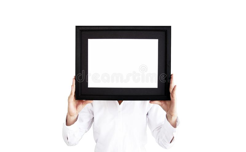 Woman in white shirt holding a photo frame. Empty picture frame royalty free stock image