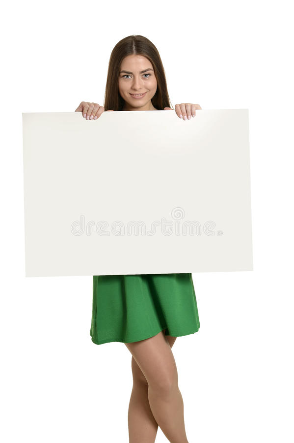 Woman and white signboard. Beautiful woman and white signboard or copyspace for slogan or text, isolated over white background stock photos