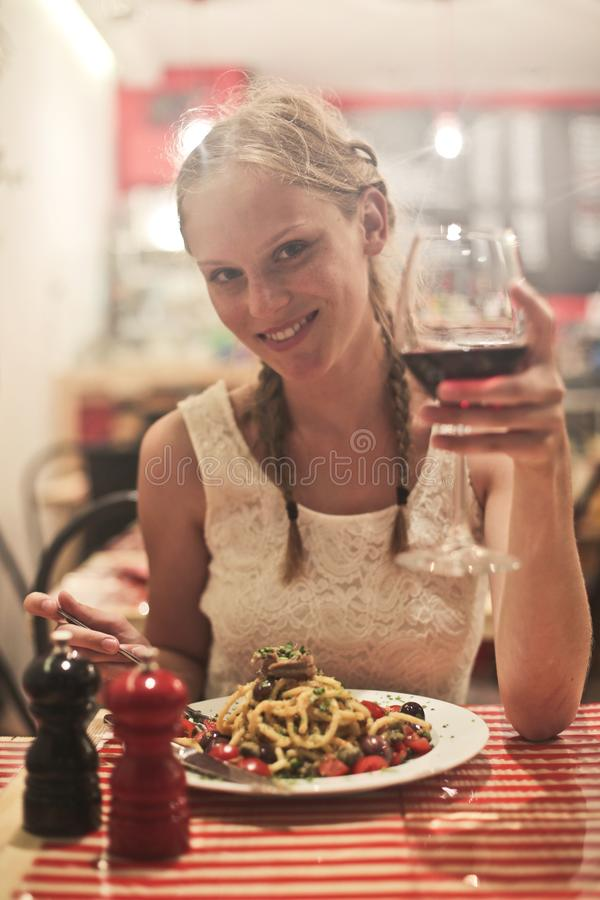 Woman in White Sleeveless Tops Holding Wine Glass royalty free stock photography