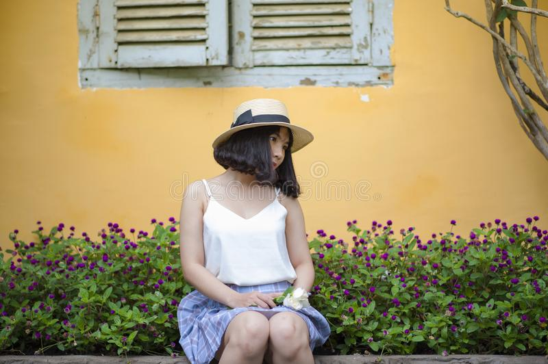 Woman In White Spaghetti Strapped Top With Blue And Purple Plaid Skirt Sitting On Ledge Near Purple Petaled Flower Garden Posing F Free Public Domain Cc0 Image