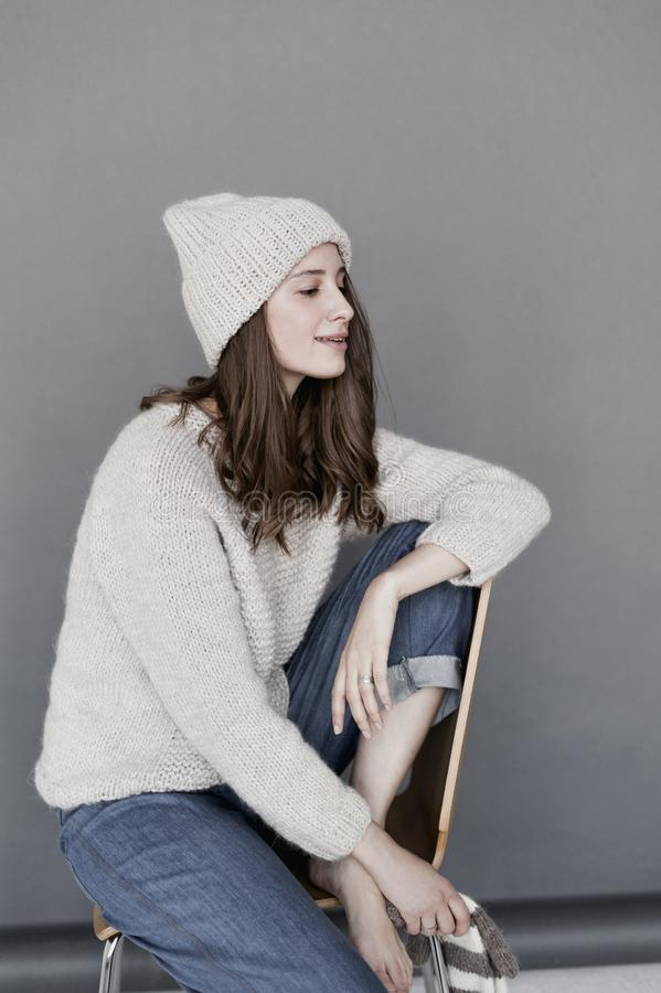 Woman in White Sweater and Beanie With Blue Denim Pants royalty free stock photos