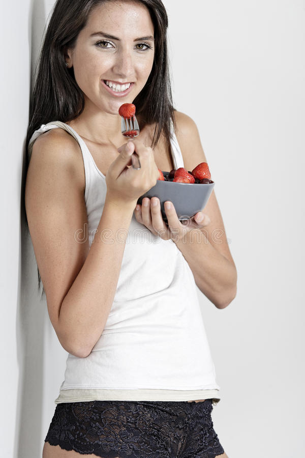 Download Woman in white vest top stock image. Image of strawberry - 26906965