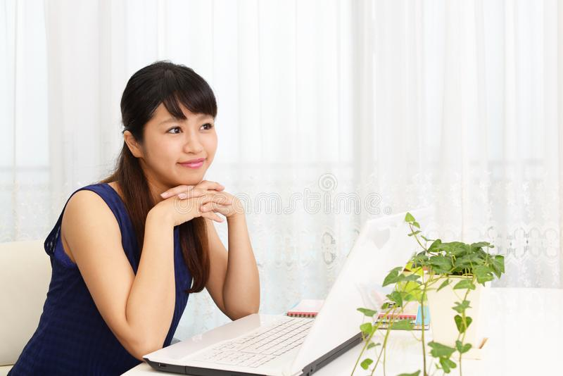 Relaxed beautiful young woman. Woman who enjoy the laptop computer royalty free stock images