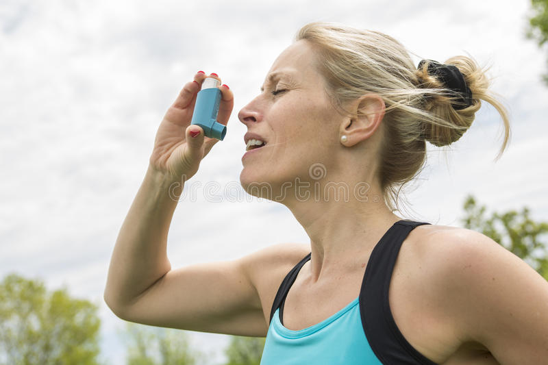 Woman who have a asthme crisis outside stock photo