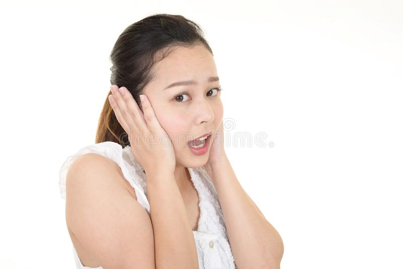 Woman who holds her ears royalty free stock photo