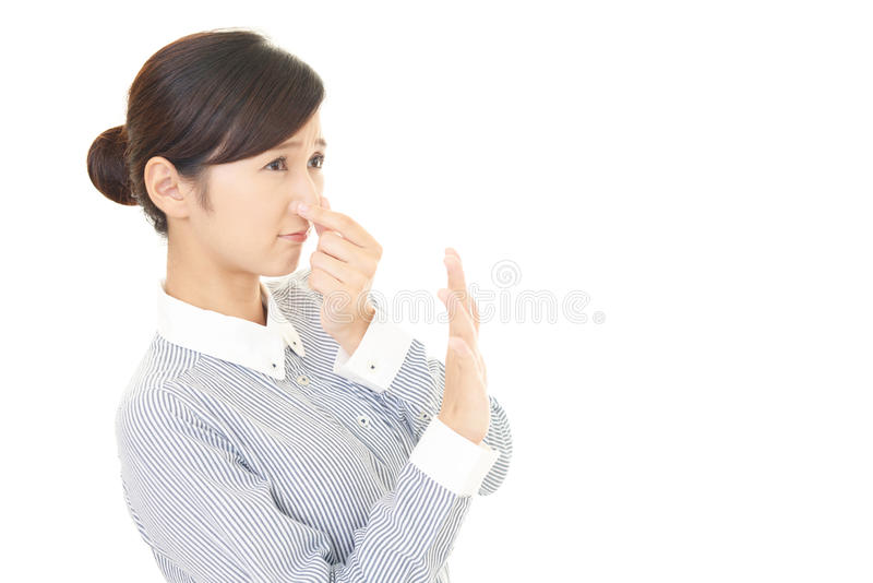 The woman who holds a nose in check royalty free stock images