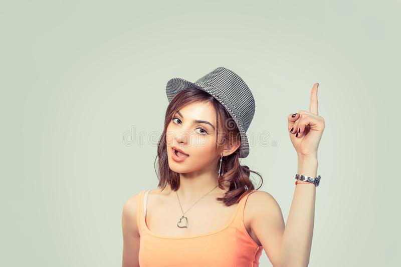 Woman who just came up with an idea aha, with finger pointing up royalty free stock photos