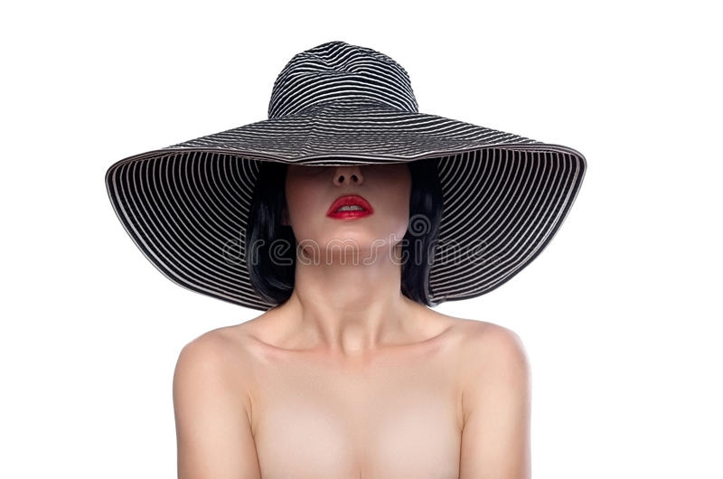 Woman in a wide brim hat. Elegant female portrait wearing wide brim hat over eyes isolated on white royalty free stock photos
