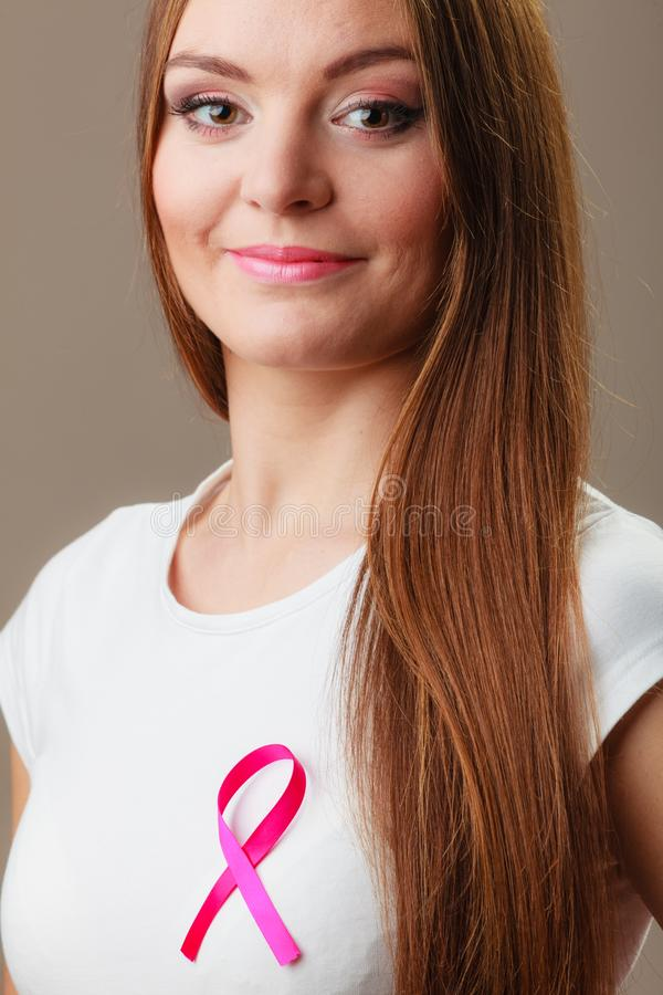 Woman wih pink cancer ribbon on chest stock photos