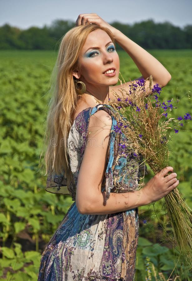 Download Woman with a wild flowers stock photo. Image of blond - 20236084