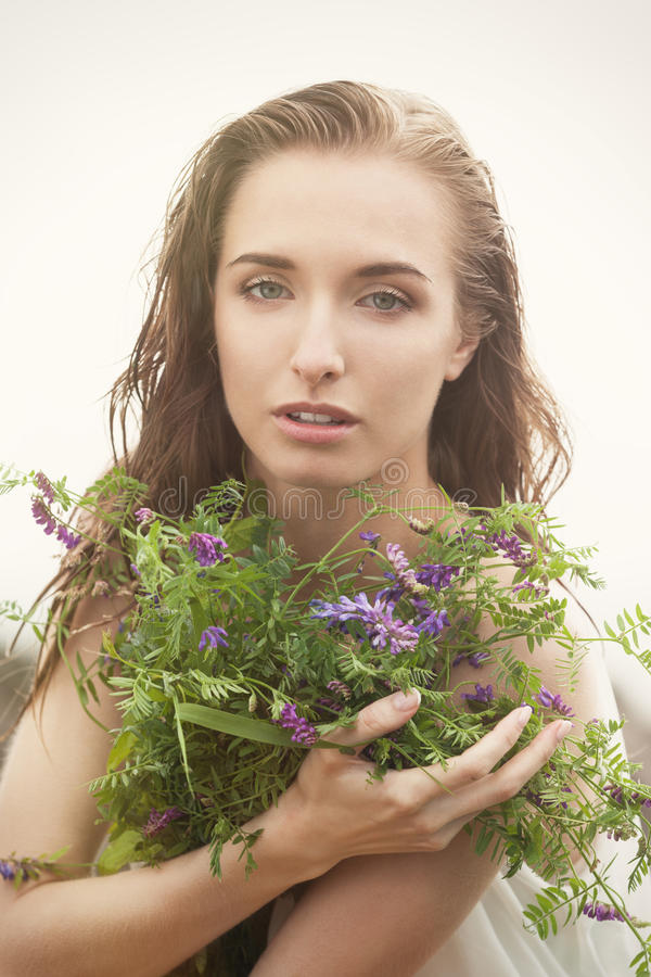Woman with wild flowers. Sensual woman with wild flowers stock image