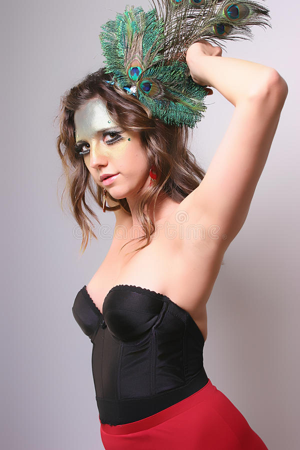 Woman with Wild Makeup with a Peacock Feather in her Hair stock photos