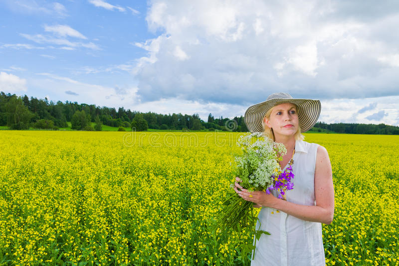Download Woman and wildflowers stock photo. Image of country, adult - 25483730
