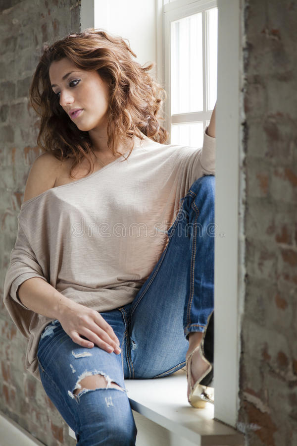 Download Woman by the window stock image. Image of sill, jeans - 30916261