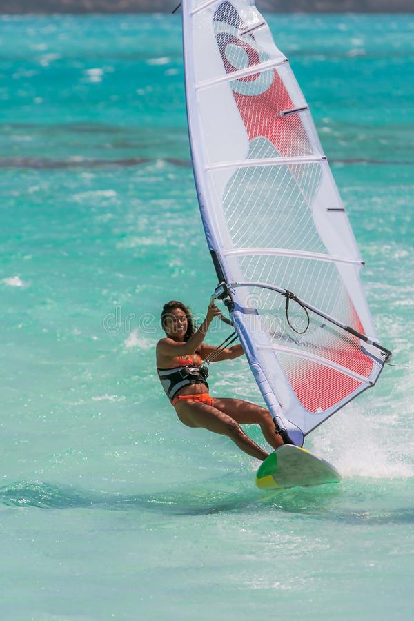 Windsurf in the lagoon. Woman windsurfing in the lagoon, acrobatic, action, active, aquatic, athletic, beach, beautiful, board, dynamic, exotic, extreme, female stock photos