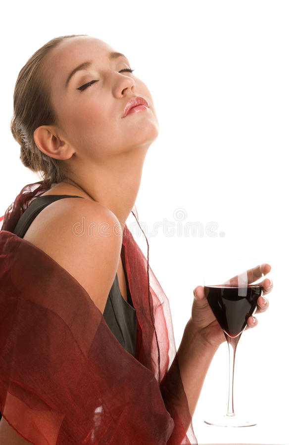Elegant woman drinking glass of red wine royalty free stock photography