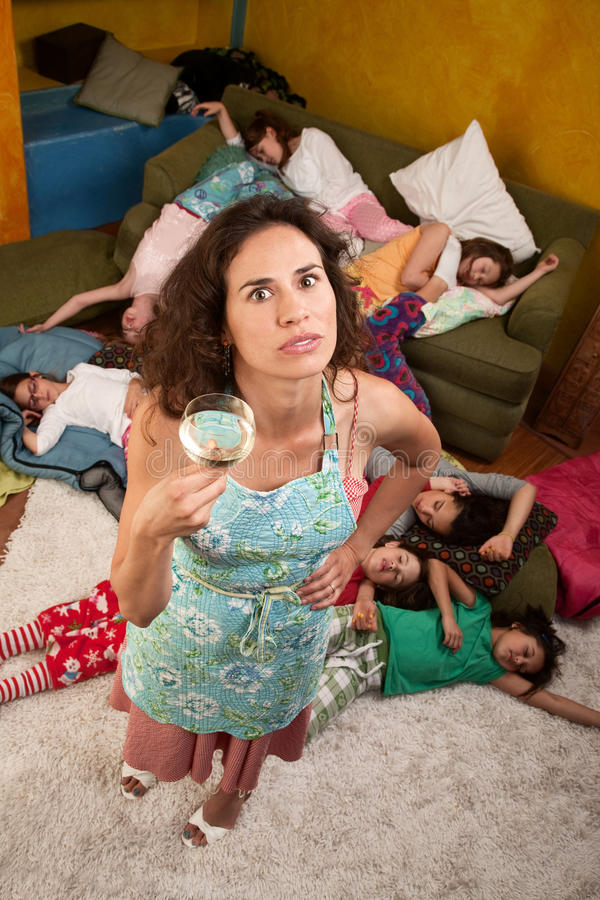Woman with wine and girls at sleepover royalty free stock photography