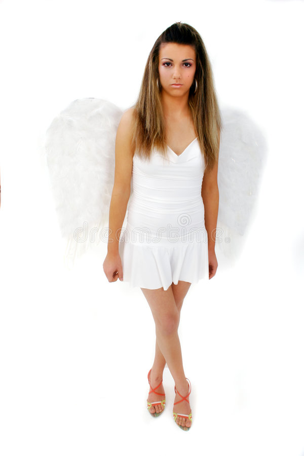 Woman with wings 2. A full-body shot of an unsmiling woman dressed in wings royalty free stock photo