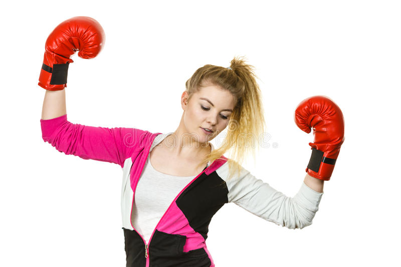 Woman winner wearing boxing gloves royalty free stock images