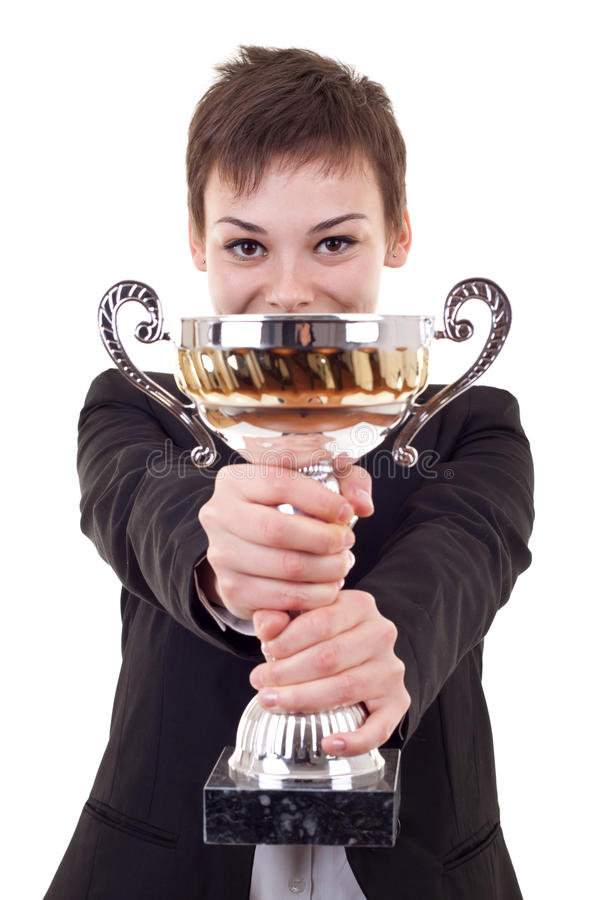 Woman winning a gold trophy. Picture of an attractive business woman winning a gold trophy royalty free stock image