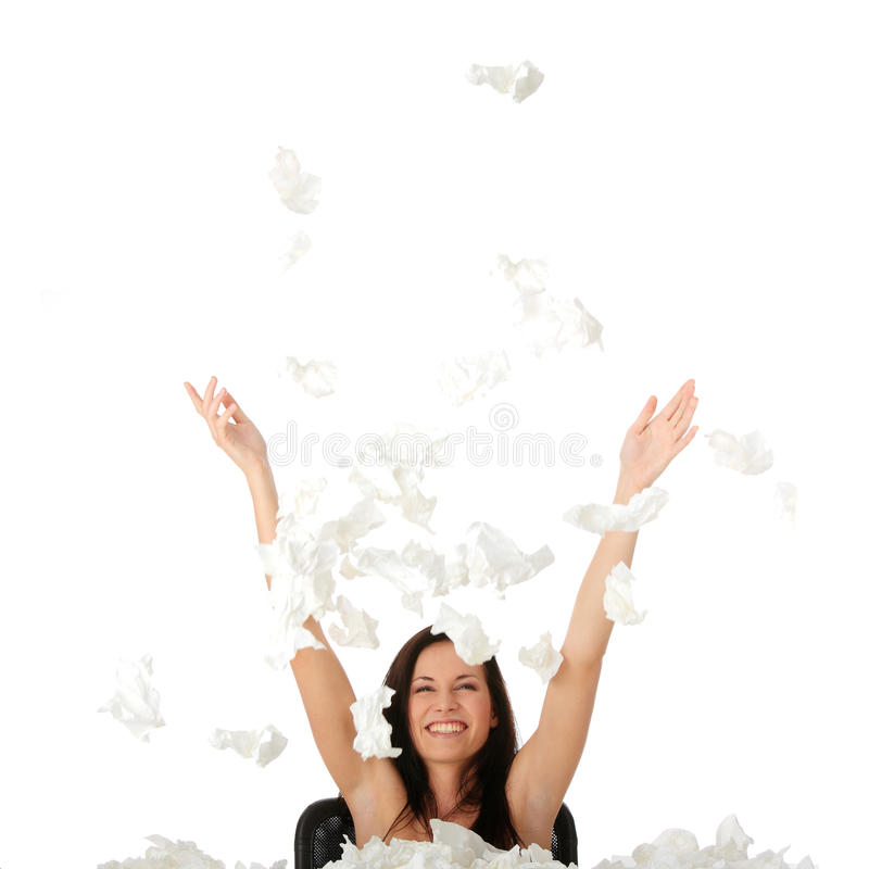 Woman winning with sickness. Throwing tisues with big smile royalty free stock photography