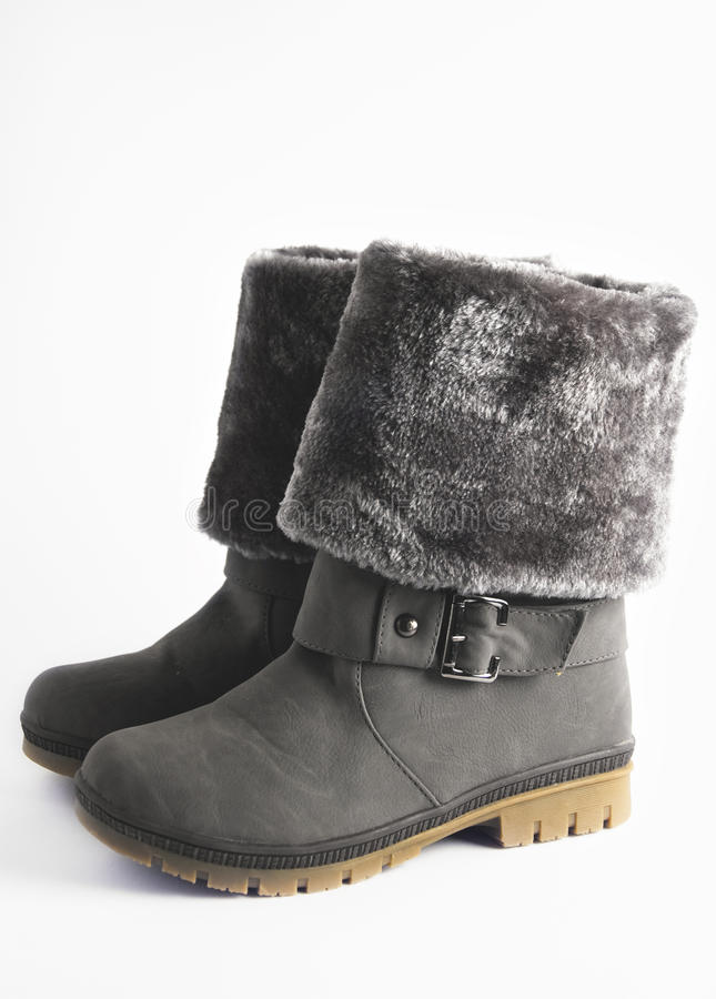 Woman winter boots. On white background stock photo