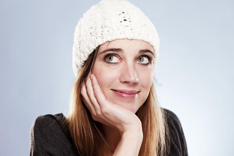 Download Woman With A Winter Cap Looking Up Royalty Free Stock Image - Image: 25009346