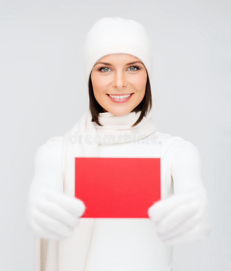 Download Woman In Winter Clothes With Blank Red Card Stock Image - Image: 34245037