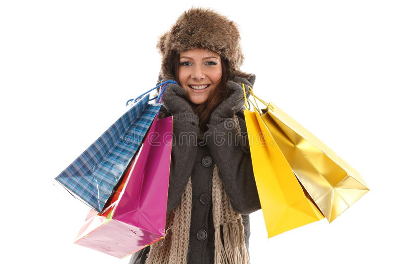 Woman in winter clothes with gifts & shopping bags royalty free stock images