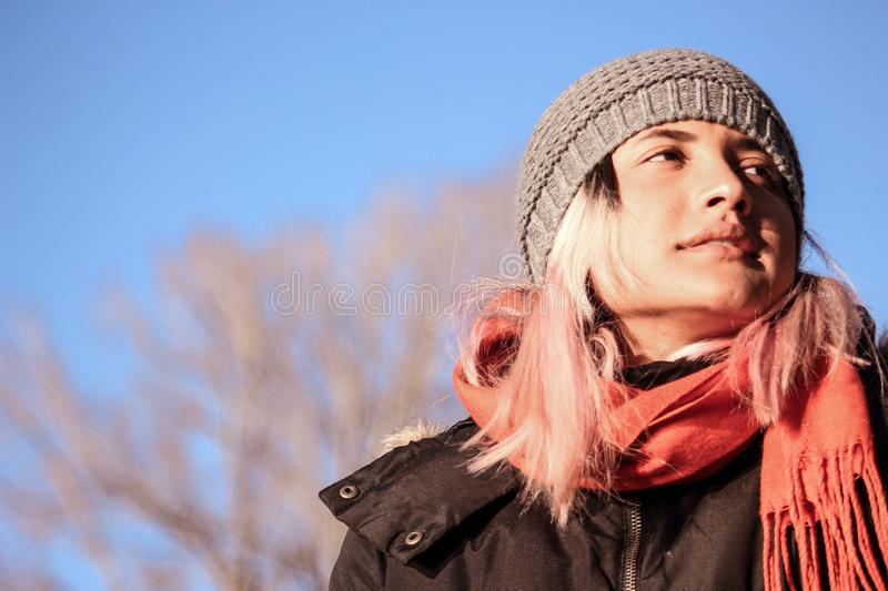 Woman with winter clothes. Scarf, coat and cap. royalty free stock photo