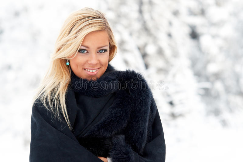 Woman in winter forest stock image
