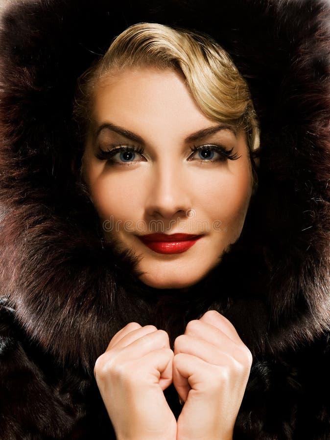 Woman in winter fur coat royalty free stock images