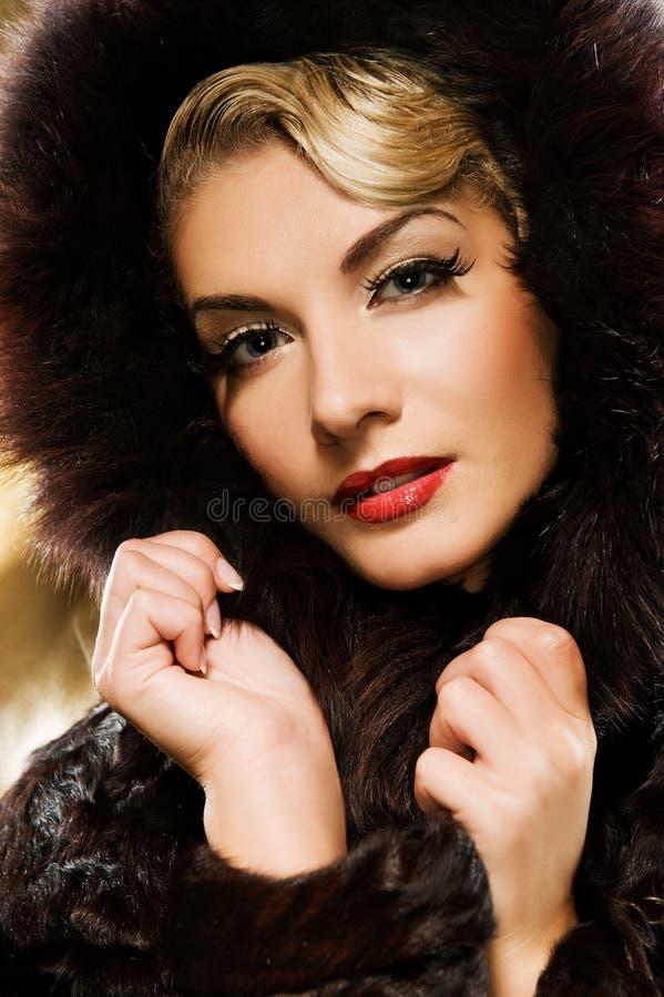 Woman in winter fur coat. Beautiful woman in winter fur coat. Retro potrait royalty free stock images