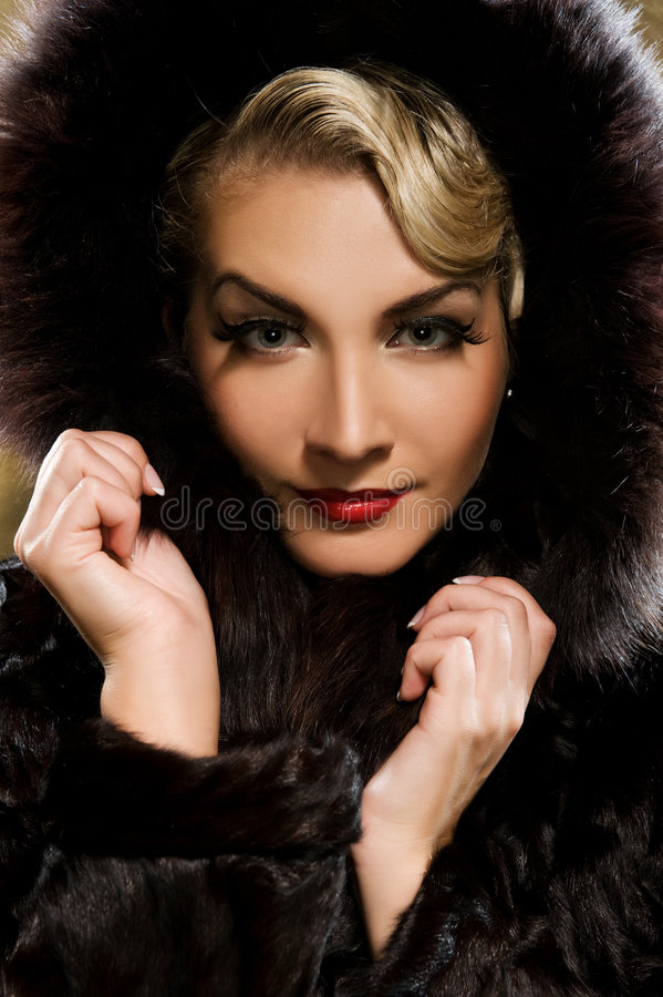 Woman in winter fur coat stock photo