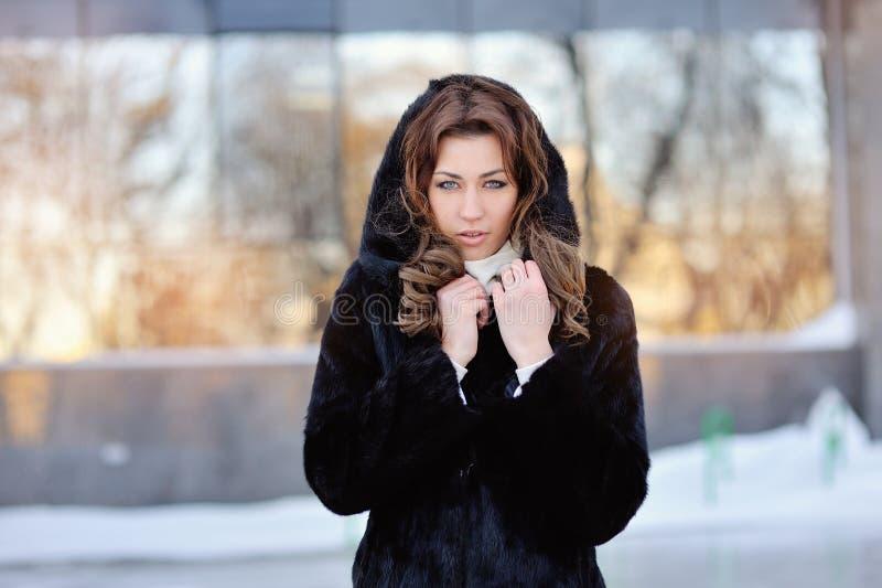 Woman in winter fur coat stock photography