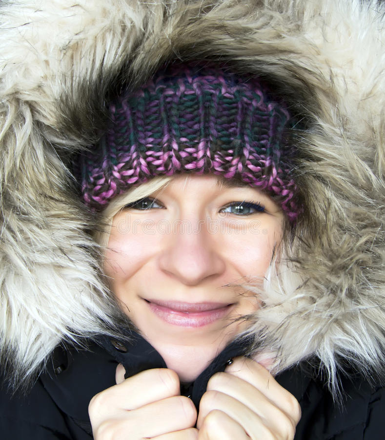 Woman in winter hood stock image