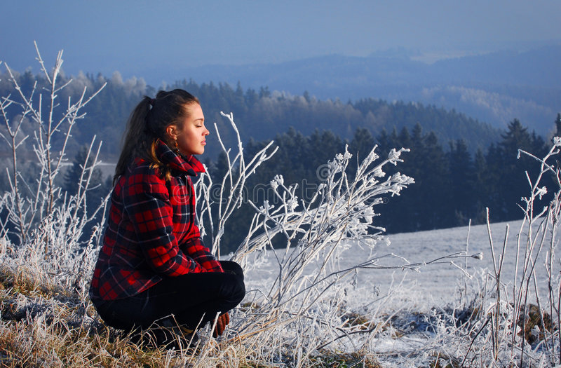 Woman and a winter landscape royalty free stock photography