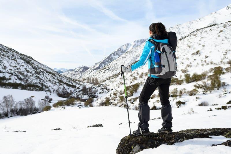 Woman winter mountain hiking stock photography