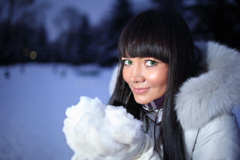 Woman winter snow. Beautiful woman holding winter snow royalty free stock photos