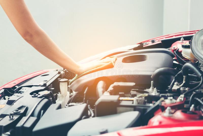 Woman wiping car engine for new vehicle, Car detailing series : stock photos