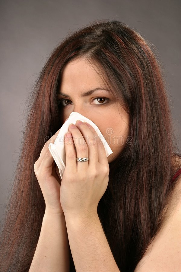 Woman wiping her nose royalty free stock photos