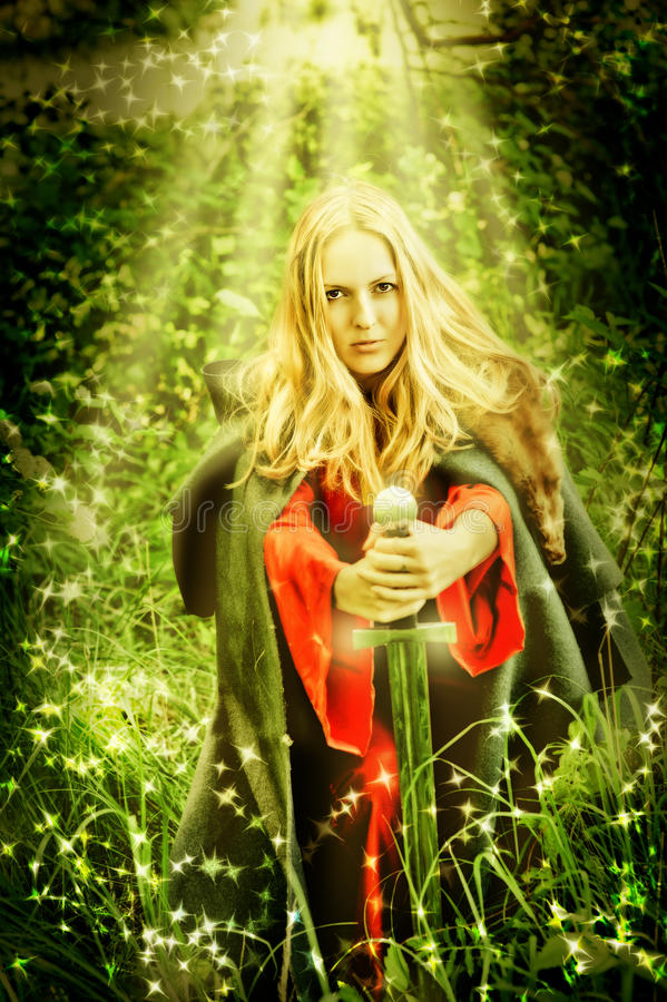Woman witch in miracle Enchanted forest. Young beautiful woman witch in miracle Enchanted forest stock photos