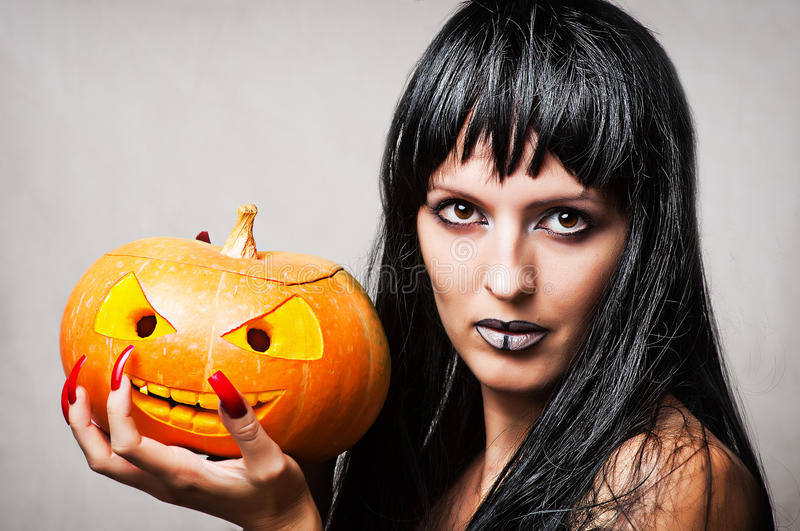 Download Woman Witch With Pumpkin Royalty Free Stock Photography - Image: 26466397