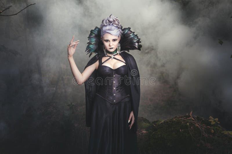 Woman witch smoke. stock photo