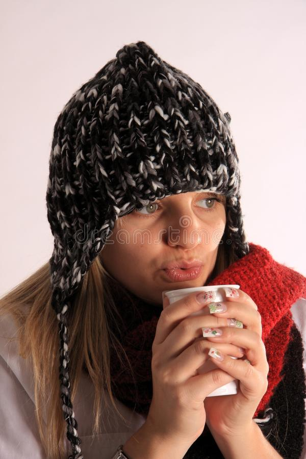 Free Woman With A Warm Hood With Hot Tea Royalty Free Stock Photography - 18539137