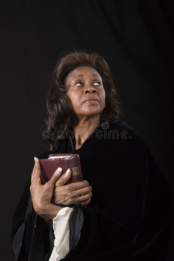 Free Woman With Bible Eyes Up Royalty Free Stock Image - 4627436