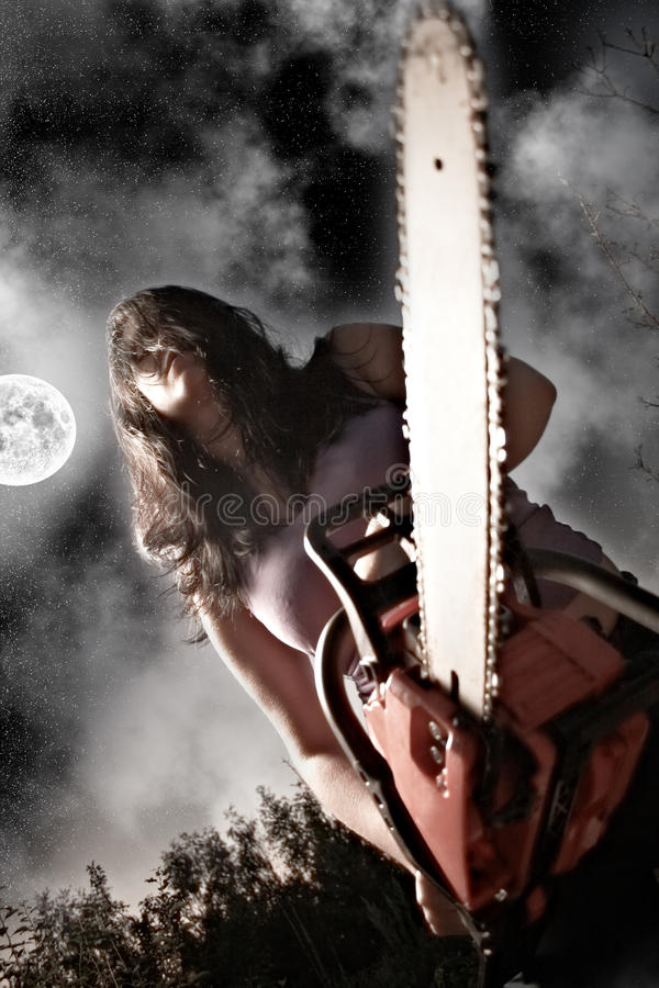 Free Woman With Chainsaw Royalty Free Stock Photos - 20563688