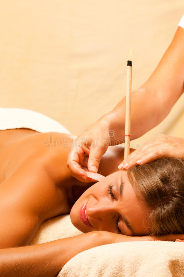 Free Woman With Ear Candles And Gem Massage Royalty Free Stock Photography - 16695377