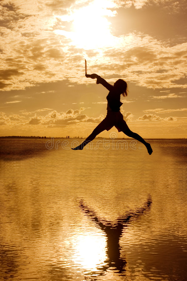 Free Woman With Laptop Jumping Around Royalty Free Stock Images - 141459