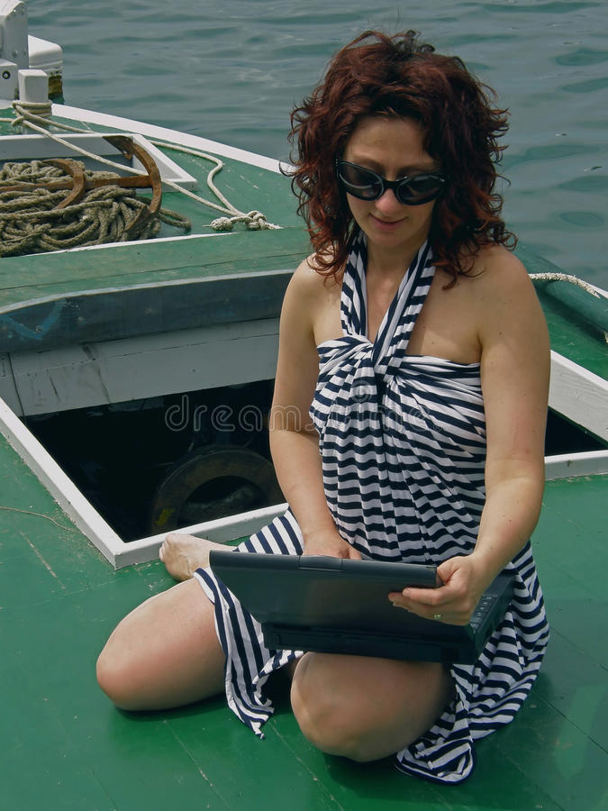 Free Woman With Laptop On Boat Stock Photo - 13075160